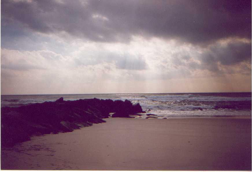 empty beach under clouds