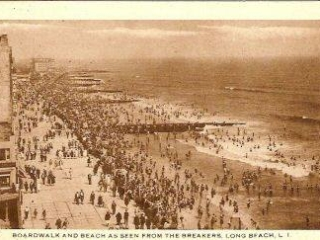 aerial view of crowded boardwalk and beach, 1928