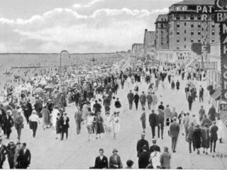 crowded boardwalk in front of Castles by the Sea