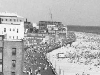 aerial view of crowded beach and boardwalk at Long Beach Blvd