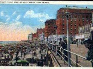 color postcard of boarwalk and crowded beach