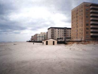 Neptune beach, with boardwalk and apartments