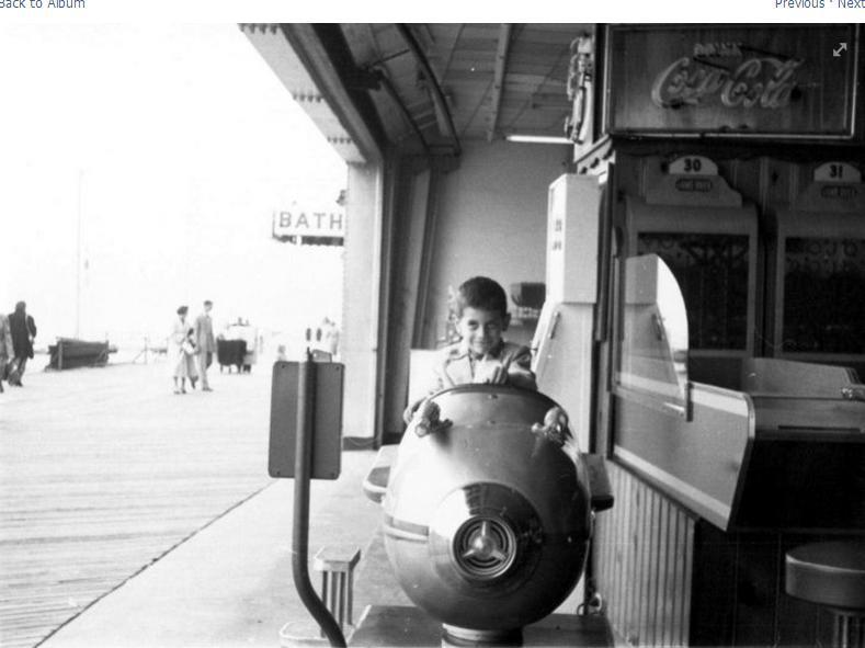 boy sitting in arcade car