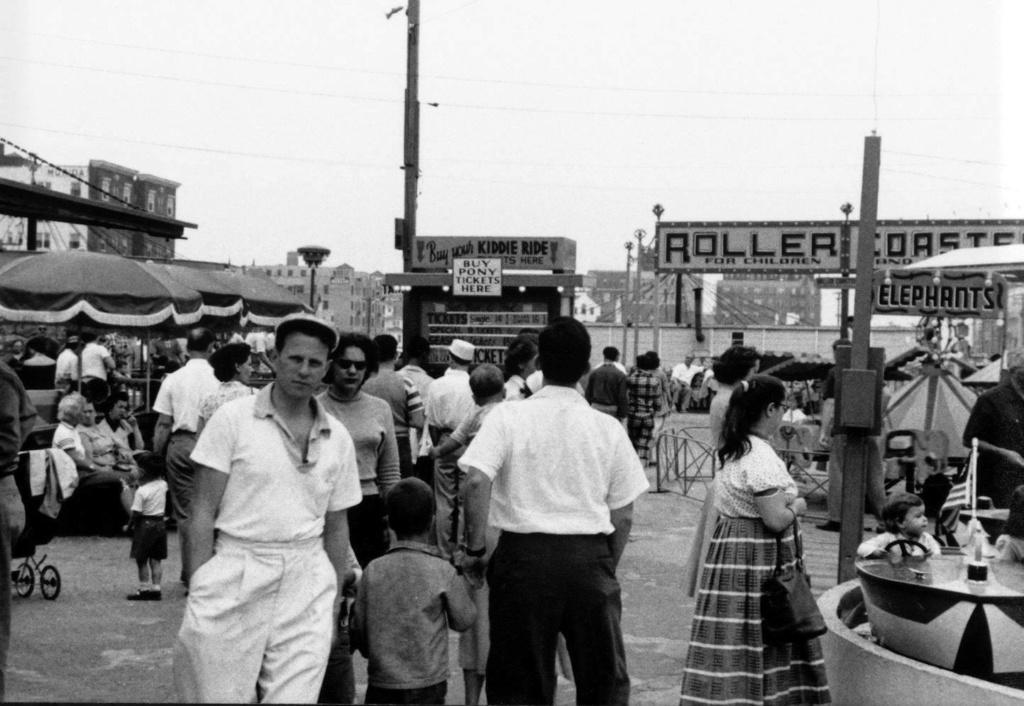 crowds in the boardwalk amusement park