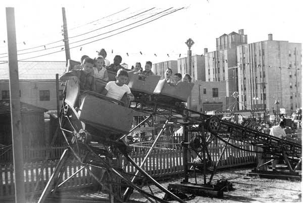 rollercoaster with buildings in background