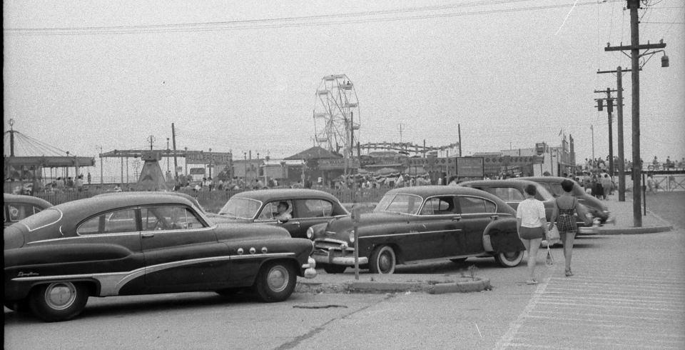 cars parked by boardwalk at Edward's Blvd