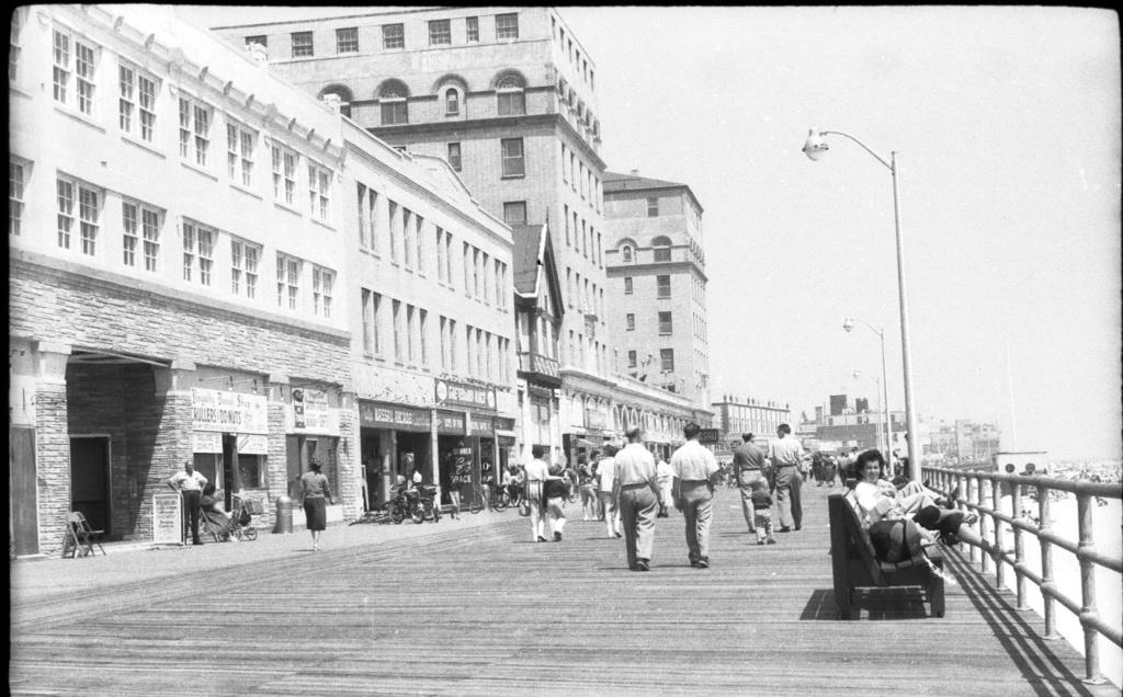 people strolling on boardwalk