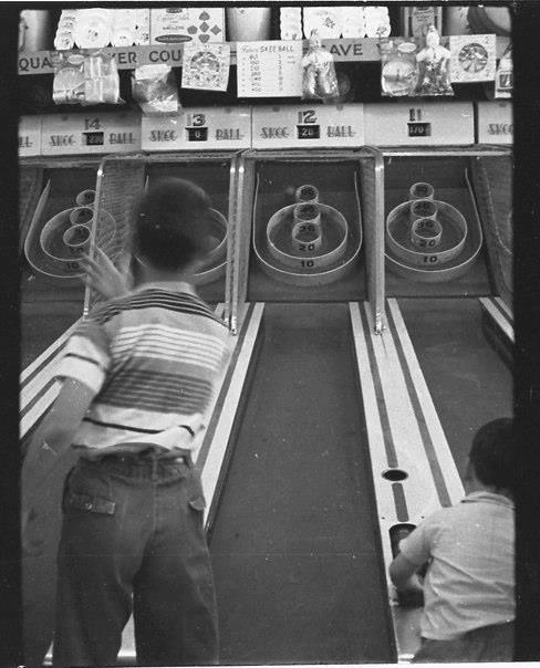 children playing skee ball